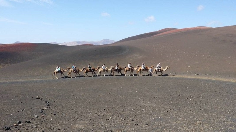 Riding a camel in Timanfaya